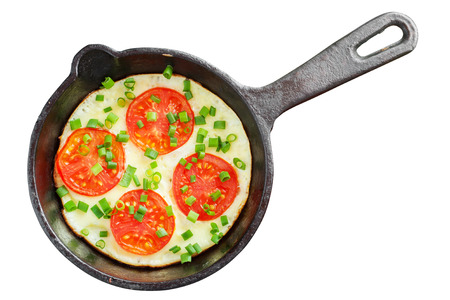 stew pan: frying pan with scrambled eggs and tomatoes isolated
