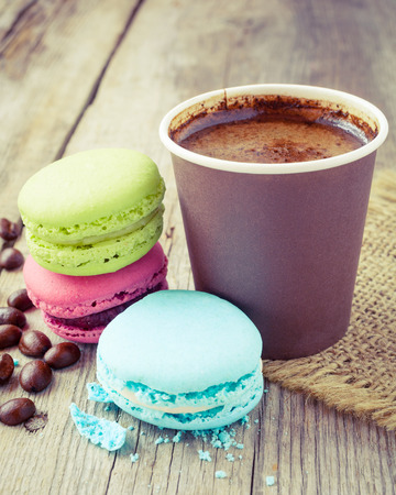 macaroons and espresso coffee cup  on wooden rustic table, vintage stylized photo photo