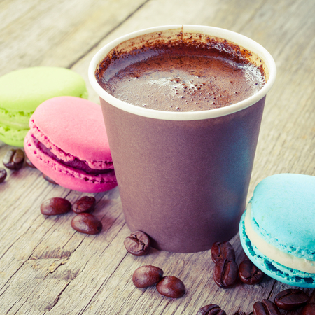 macaroons and espresso coffee cup on old wooden rustic table photo