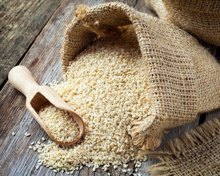 gunny bag: sesame seeds in sack on wooden rustic table