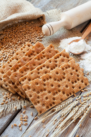 wholemeal: grain rye Crispbread, cereal crackers on wooden rustic table