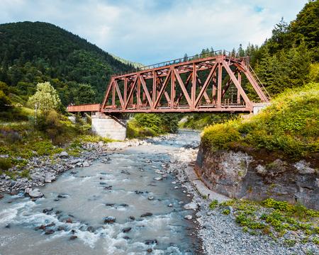 Railroad trestle over the mountain river, Carpathians photo