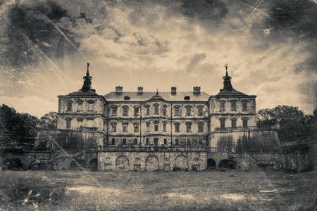 spooky: Pidhirtsi Castle, village Podgortsy, Renaissance Palace, Lviv region, Ukraine. Retro stylized photo in black and white colors