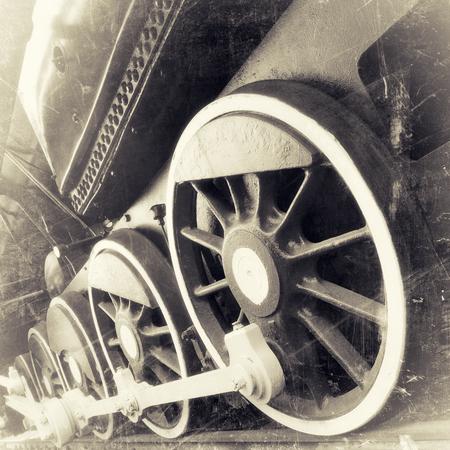 black train: steam locomotive wheels close up in retro black and white design, vintage stylized