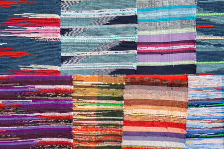 rug texture: Texture of traditional colorful rug textile. Ethnic carpet or cover design