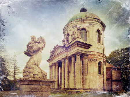 exaltation: Statues and Roman Catholic church of the Exaltation of the Holy and St. Joseph. Pidhirtsi Castle, Lviv region, Ukraine. Retro stylized photo.
