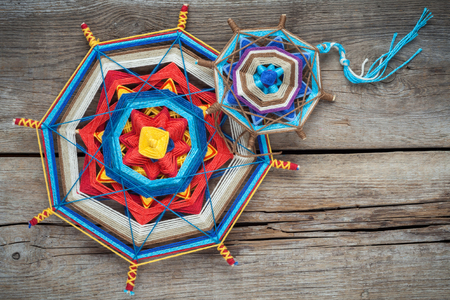 tantra: Two knitted tibetan mandala from threads, top view Stock Photo
