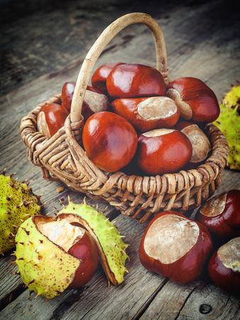 auburn: chestnuts in basket on wooden table