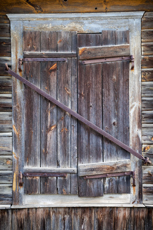 abandoned house window: closed rustic window of old wooden house Stock Photo