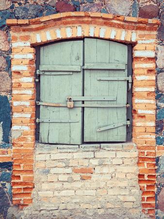 ramshackle: closed rustic window of old  house