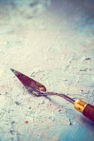 priming paint: palette knife on artist canvas with coating of oil paint Stock Photo