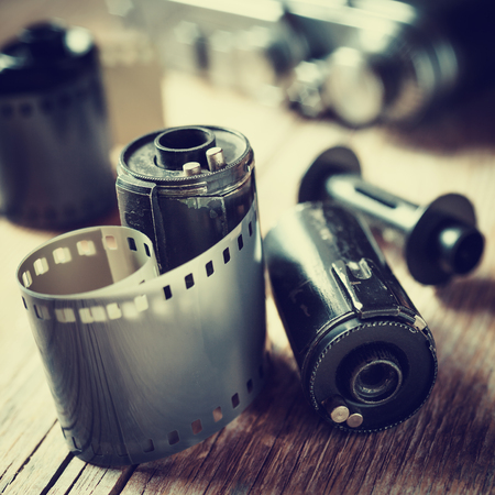 photography studio: Old photo film rolls, cassette and retro camera. Vintage stylized.