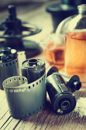 reagents: Old photo film rolls, cassette and chemical reagents for photographic film. Vintage stylized. Stock Photo