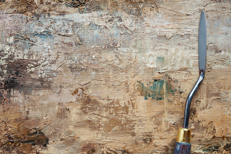 priming paint: palette knife on linen artist canvas with coating of brown oil paint