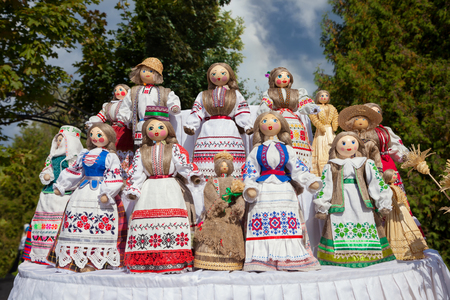 country store: Traditional belorussian dolls in national clothes at market. Stock Photo