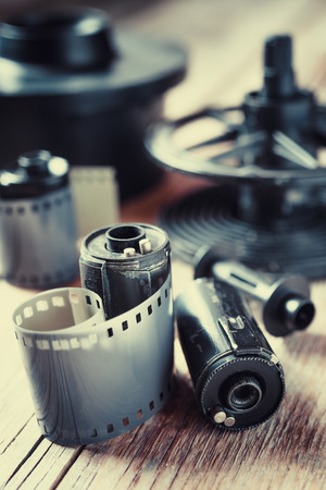 photographic film: Old photo film rolls, cassette and photographic equipment. Vintage stylized.