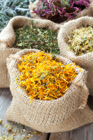 hessian: Healing herbs in hessian bags, herbal medicine.