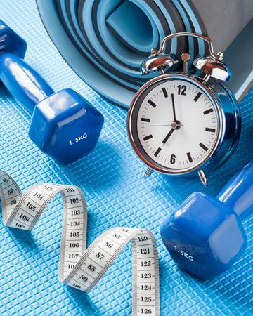 kilos: Yoga mat, two dumbbells, tape measure and alarm clock.