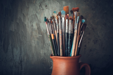 Paintbrushes in a jug from potters clay.