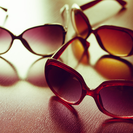 tinted glasses: Fashionable sunglasses. Vintage stylized.