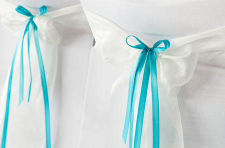 wedding chairs: Wedding chairs with brown ribbons. Stock Photo