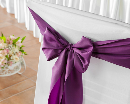 wedding chairs: Wedding chairs with violet ribbon. Stock Photo