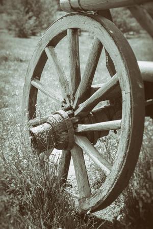 Vintage stylized photo of wooden cart wheel Stock Photo