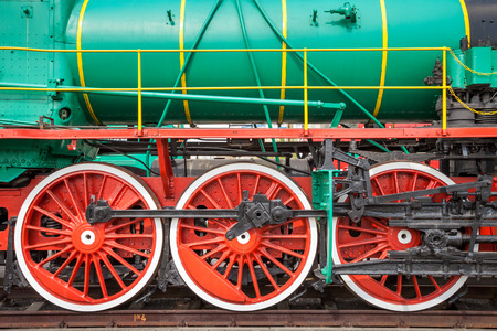 steam locomotive: Fragment of old steam locomotive on rails Stock Photo
