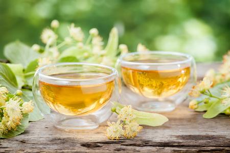 linden tea: Two cups of healthy linden tea, herbal medicine. Stock Photo