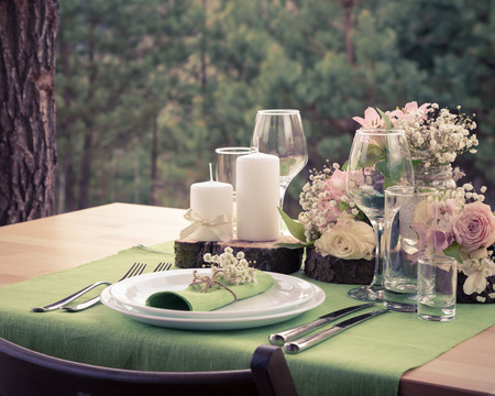 decors: Wedding table setting in rustic style. Vintage stylized photo.