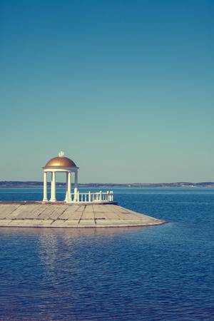 gazebo: Classic gazebo with column on shore