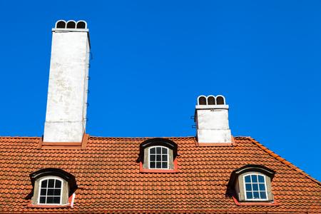 garret: Garret roof with window and chimney, Riga, Latvia