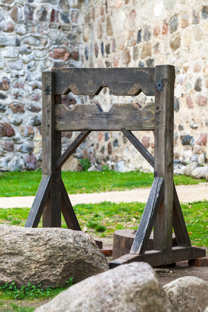 humiliated: Wooden medieval torture device, ancient pillory.
