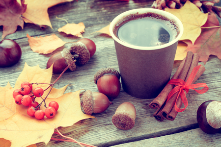 Warming coffee cup and autumn still life on old table Stock Photo