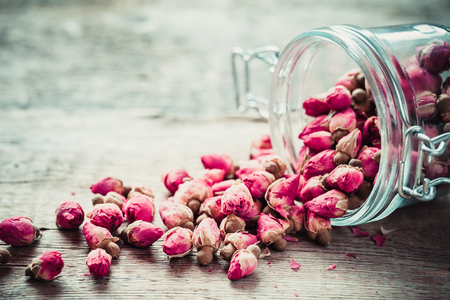 dried flowers: Rose buds in glass jar. Selective focus.