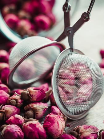 chinese tea ceremony: Rose buds tea, tea strainer and glass jar closeup. Selective focus.