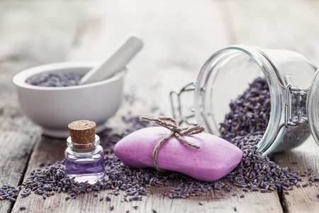 Bars of homemade soaps, dry lavender flowers and essential oil. Selective focus.