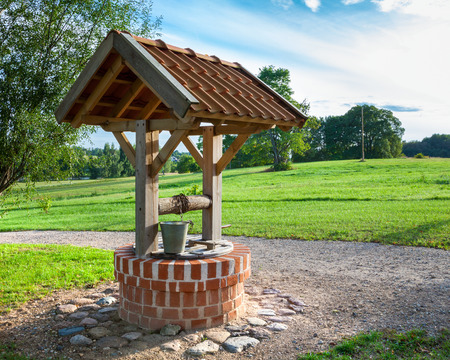 Retro wooden well water Standard-Bild