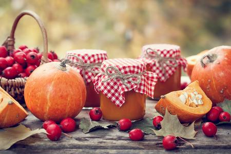 preserve: Pumpkin jam, puree or sauce and hawthorn berries. Autumn still life. Selective focus. Stock Photo