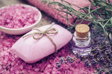 spa still life: Bar of homemade soaps, sea salt, essential oil and dry lavender flowers. Selective focus.