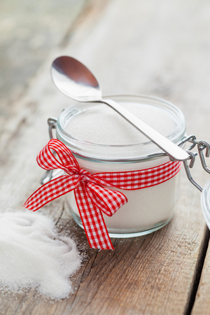 sweeten: Sugar bowl with spoon on kitchen table Stock Photo