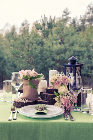 Wedding table setting in beautiful rustic style.