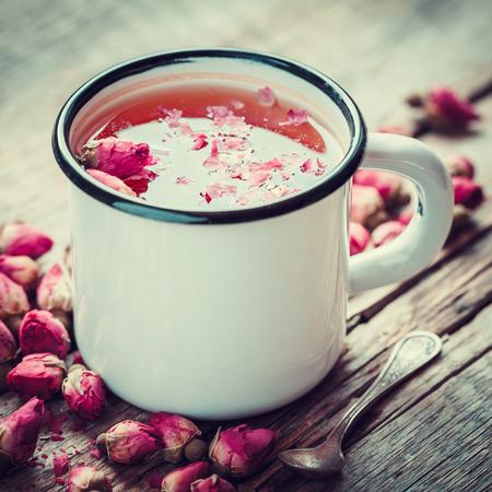 Rose buds tea in tea cup. Retro toned.