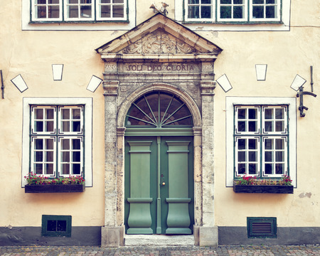 old building facade: Vintage door on  a medieval building facade in old Riga city, Latvia Stock Photo