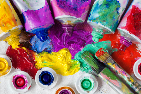 priming brush: Tubes of oil paint, palette and artist paintbrushes closeup. Stock Photo