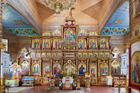 iconostasis: Interior of Orthodox Christian church near Manyavsky monastery - altar, iconostasis, and beautiful icons, frescoes in natural lighting.