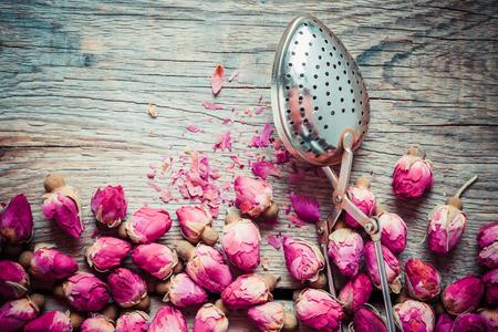tea strainer: Dry rose buds tea and tea infuser. Top view.