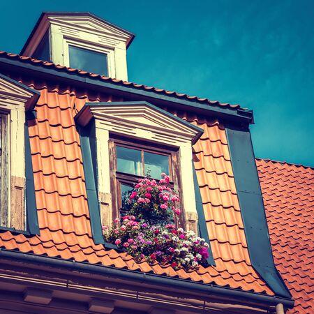 garret: Window with flower box in old garret roof.