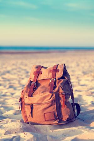Travel Backpack on Summer Sea Beach. Retro styled.
