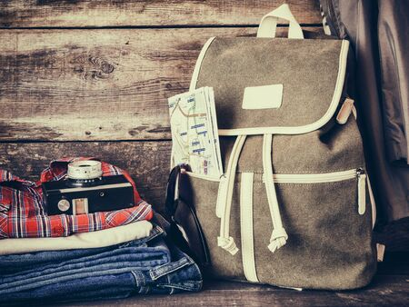 rucksack ': Travel backpack,  clothing, map, filmstrip and retro film camera. Vintage stylized. Stock Photo